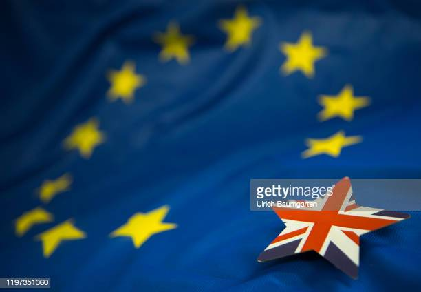 Brexit The symbol photo shows a European flag with a missing star The missing star lies separately on the European flag