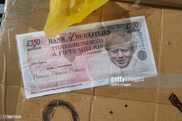 """Brexit """"Three Hundred and fifty million"""" pound note is seen outside Houses of Parliament in Westminster in London. UK will not leave the EU on 31..."""