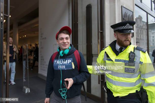 Brexiteer Trump supporter and climate change denier counter protesting the Youth strike for climate is seen been removed by a police officer Students...