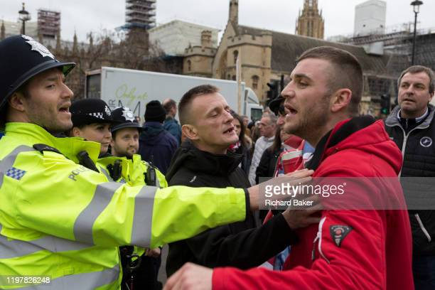 A Brexiteer yells at a police officer on Brexit Day the day when the UK legally leaves the European Union in Westminster on 31st January 2020 in...