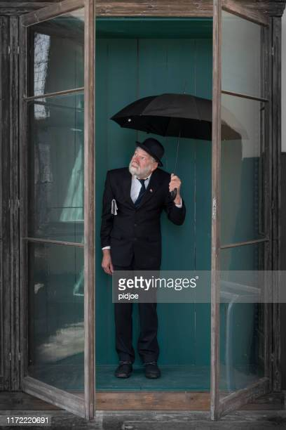 brexit;typical englishman with bowler hat - black hat stock pictures, royalty-free photos & images