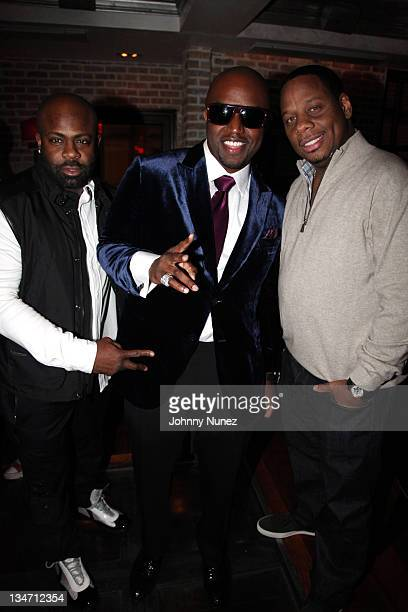 Breyon Prescott Rico Love and Kendu Isaacs attend Rico Love's birthday party on December 2 2011 at Vic and Angelo's in Miami Beach Florida