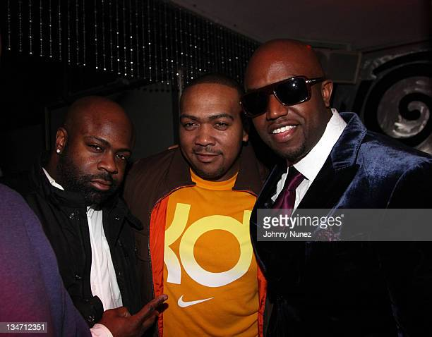Breyon Prescott Timbaland and Rico Love celebrate Rico Love's birthday on December 2 2011 at Vic and Angelo's in Miami Beach Florida