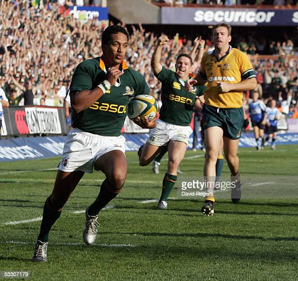 Breyton Paulse the Springbok wing races away from Chris Latham to score their only try during the TriNations international rugby match between South...