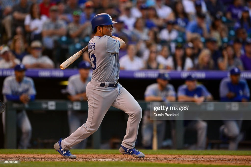 Breyvic Valera #33 of the Los Angeles Dodgers hits a 2-RBI single against the Colorado Rockies in the seventh inning at Coors Field on June 2, 2018 in Denver, Colorado.