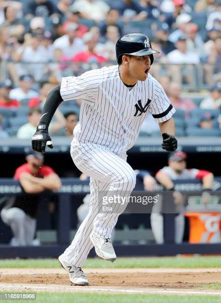 Breyvic Valera of the New York Yankees celebrates his RBI single in the fourth inning against the Boston Red Sox during game one of a double header...