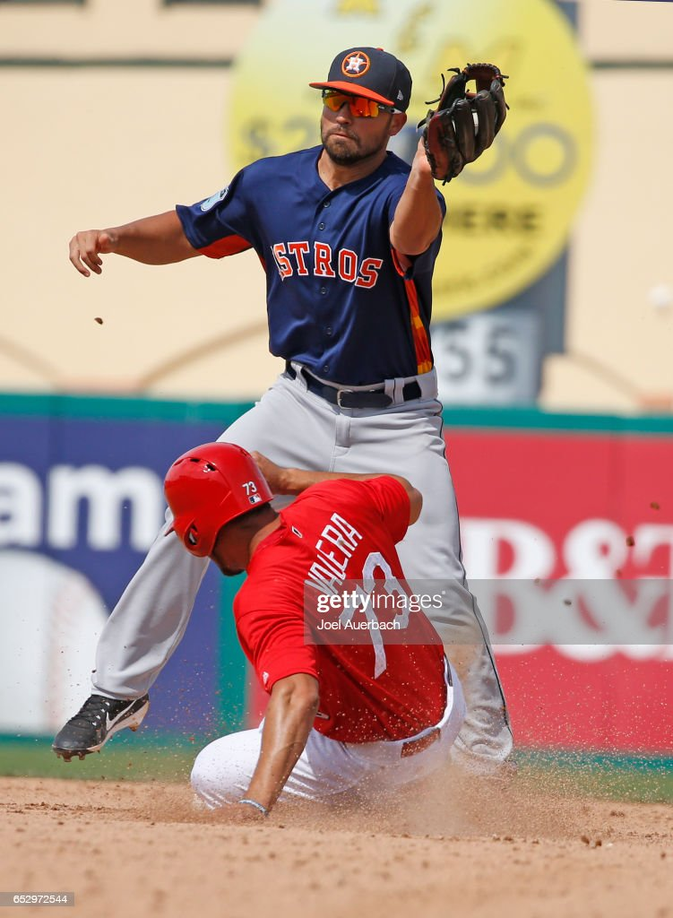 Breyvic Valera #73 of the St Louis Cardinals steals second base under the tag by Jack Mayfield of the Houston Astros in the eighth inning during a spring training game at Roger Dean Stadium on March 13, 2017 in Jupiter, Florida. The Cardinals defeated the Astros 6-3.