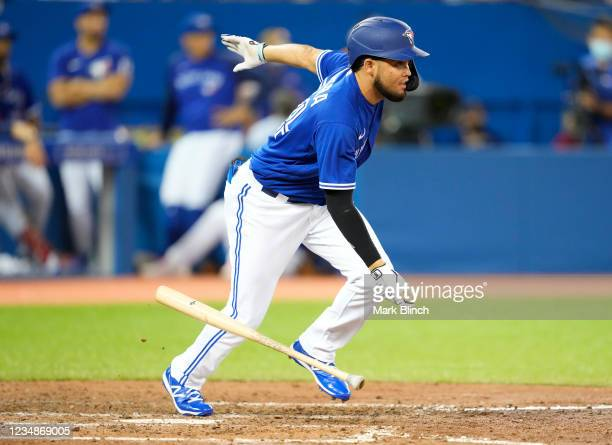 Breyvic Valera of the Toronto Blue Jays singles against the Chicago White Sox in the eighth inning during their MLB game at the Rogers Centre on...