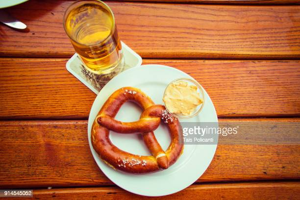 brezel (prezel), traditional cheese obatzda and a glass of beer - bavaria, germany, europe - コブレンツ ストックフォトと画像