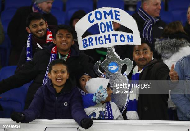 Brghton fans hold a tin foil FA Cup prior to The Emirates FA Cup Third Round match between Brighton Hove Albion and Crystal Palace at Amex Stadium on...