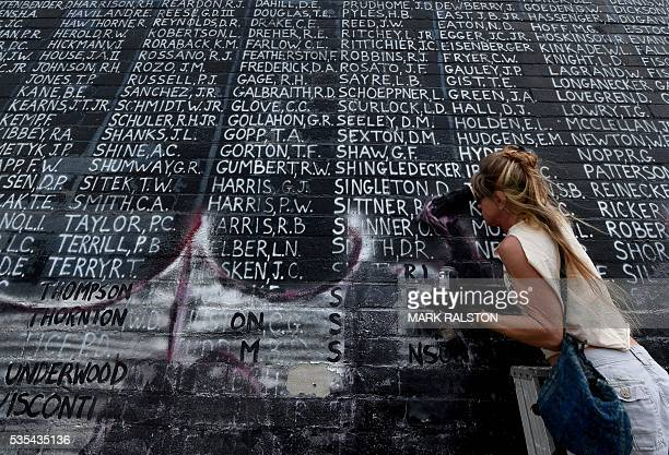 Bri Corry joins veterans and other community members to help cleanup a Veterans Memorial containing the names of 2273 unaccounted and missing in...