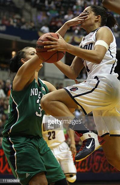 Bria Hartley of the Connecticut Huskies is hit by Becca Bruszewski of the Notre Dame Fighting Irish during the semifinals of the 2011 NCAA Women's...