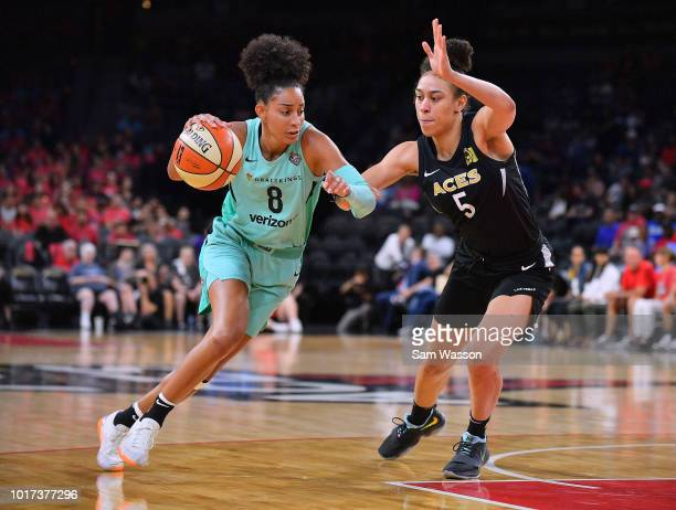 Bria Hartley of the New York Liberty drives against Dearica Hamby of the Las Vegas Aces at the Mandalay Bay Events Center on August 15 2018 in Las...