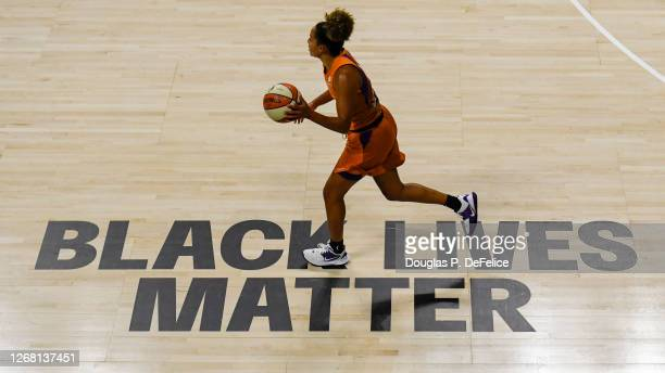 Bria Hartley of the Phoenix Mercury dribbles the ball over a Black Lives Matter sign painted on the floor during the second half against the...