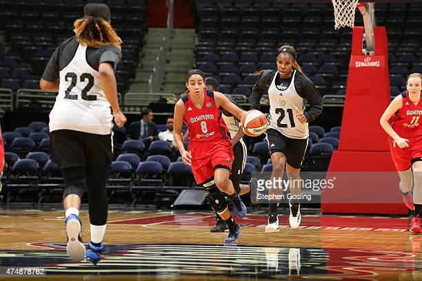 Bria Hartley of the Washington Mystics drives against the Minnesota Lynx during an Analytic Scrimmage at the Verizon Center on May 26 2015 in...