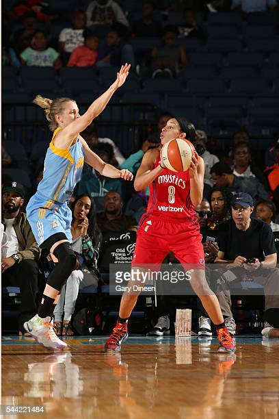 Bria Hartley of the Washington Mystics looks to pass the ball Allie Quigley of the Chicago Sky on July 1 2016 at Allstate Arena in Rosemont IL NOTE...