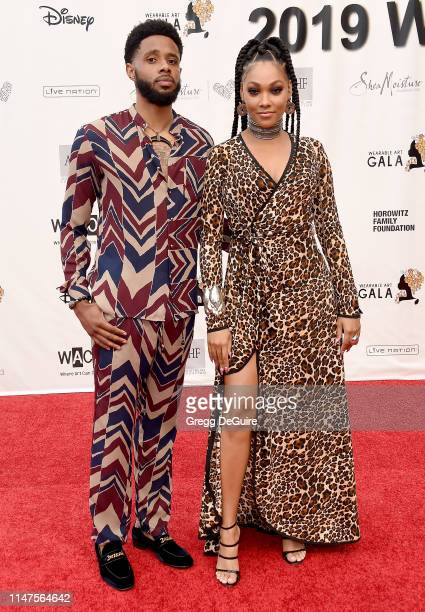 Bria Murphy and Larry Drew arrive at the WACO Theater Center's 3rd Annual Wearable Art Gala at The Barker Hangar at Santa Monica Airport on June 1...