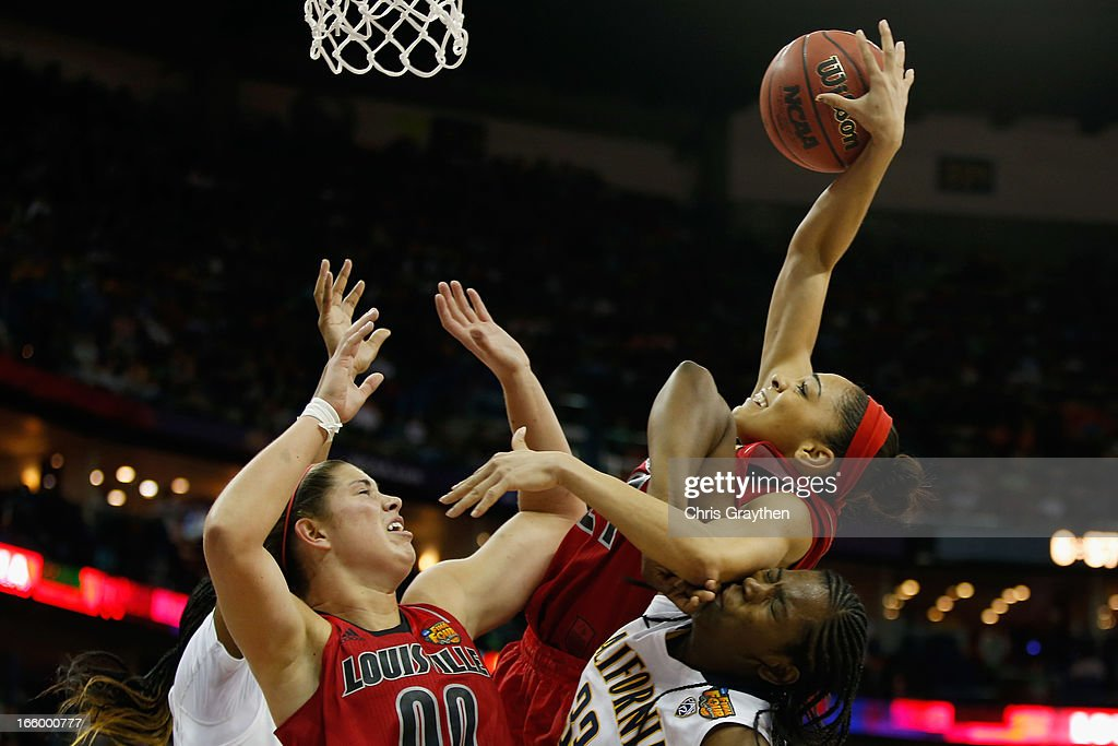 Bria Smith #21 of the Louisville Cardinals grabs a rebound over Talia Caldwell #33 of the California Golden Bears during the National Semifinal game of the 2013 NCAA Division I Women's Basketball Championship at the New Orleans Arena on April 7, 2013 in New Orleans, Louisiana. The Cardinals defeated the Golden Bears 64-57.