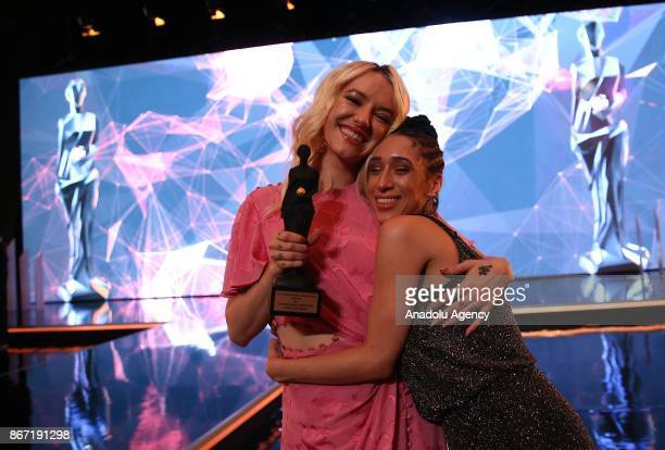 Bria Vinaite and Mela Murder celebrate after receiving their award during the closing ceremony of 54th International Antalya Film Festival at Antalya...