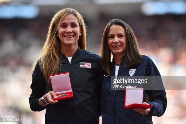 Briain's Jo Pavey poses with her bronze medal and US athlete Kara Groucher receives her silver medal during the medal reallocation victory ceremony...