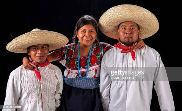 Brian Alberto Garcia Vazquez Lorena Garcia Vidal and Julio Cesar Rojano Garcia pose for a photograph with their traditional costumes during the...
