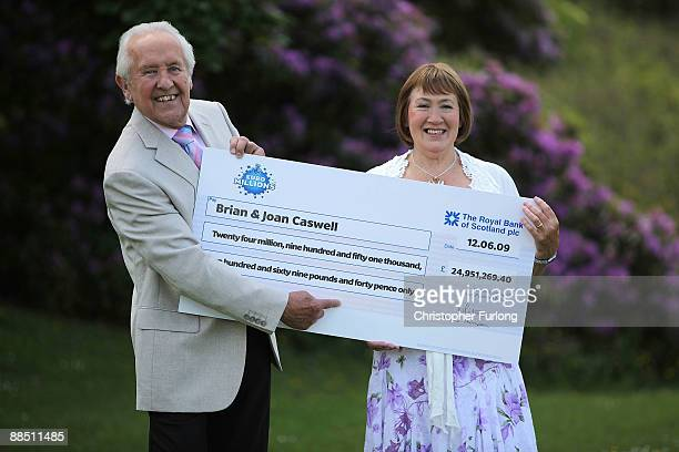 Brian and Joan Caswell pose for the media after winning GBP 249 million in the EuroMillions Lottery on June 16 2009 in Macclesfield England The...