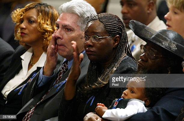 Brian and Valorie Brabazon stepfather and mother of Patrick James Dennehy hold back tears during his memorial service August 7 2003 at the Jubilee...