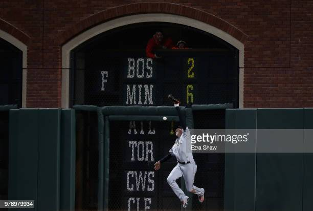 Brian Anderson of the Miami Marlins can not catch a ball hit by Alen Hanson of the San Francisco Giants in the fifth inning at ATT Park on June 19...