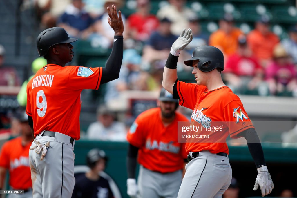 Brian Anderson #15 of the Miami Marlins celebrates with Lewis Brinson after hitting a two run homer during the first inning of the Spring Training game against the Detroit Tigers at Joker Marchant Stadium on March 02, 2018 in Lakeland, Florida.
