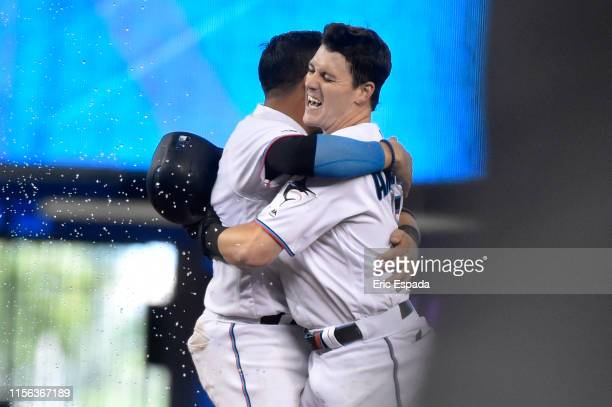 Brian Anderson of the Miami Marlins celebrates with Miguel Rojas after hitting a walk off single to defeat the San Diego Padres at Marlins Park on...
