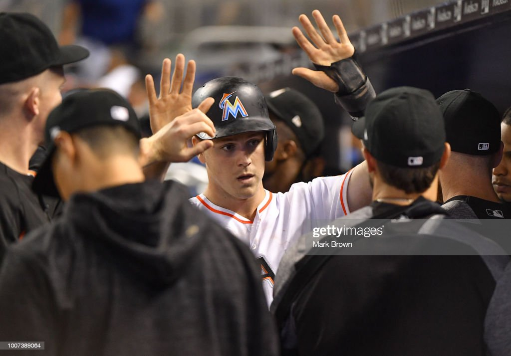 Brian Anderson #15 of the Miami Marlins celebrates with teammates after scoring a run in the fifth inning against the Washington Nationals at Marlins Park on July 29, 2018 in Miami, Florida.