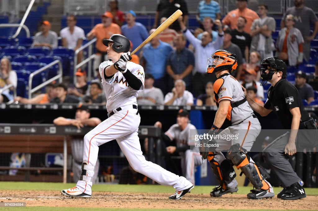 Brian Anderson #15 of the Miami Marlins hits a sacrifice fly with the bases loaded in the ninth inning against the San Francisco Giants at Marlins Park on June 13, 2018 in Miami, Florida.