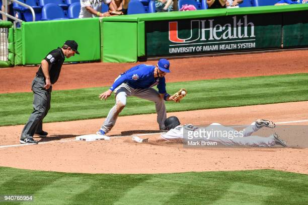 Brian Anderson of the Miami Marlins is tagged out at third by Kris Bryant of the Chicago Cubs in the fifth inning against the Chicago Cubs at Marlins...