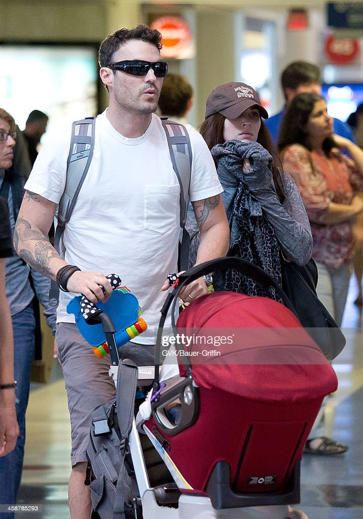 Brian Austin Green, Megan Fox and their son Noah Green are seen at Los Angeles International Airport on July 07, 2013 in Los Angeles, California.