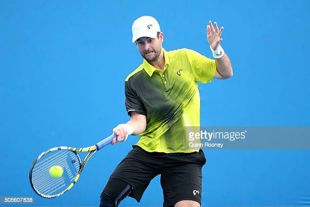 Brian Baker of the United States plays a forehand in his first round match against Simone Bolelli of Italy during day two of the 2016 Australian Open...