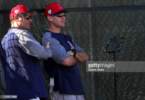 Brian Bannister assistant pitching coach for the Boston Red Sox and Dave Bush minor league pitching coordinator use an array of technology during a...