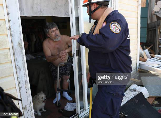 Brian Bartlett from the South Florida Search and Rescue team checks in on Tom Garcia after Hurricane Michael passed through the area on October 11...