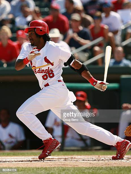 Brian Barton of the St Louis Cardinals follows through against the Florida Marlins during a Spring Training game at Roger Dean Stadium on March 2...