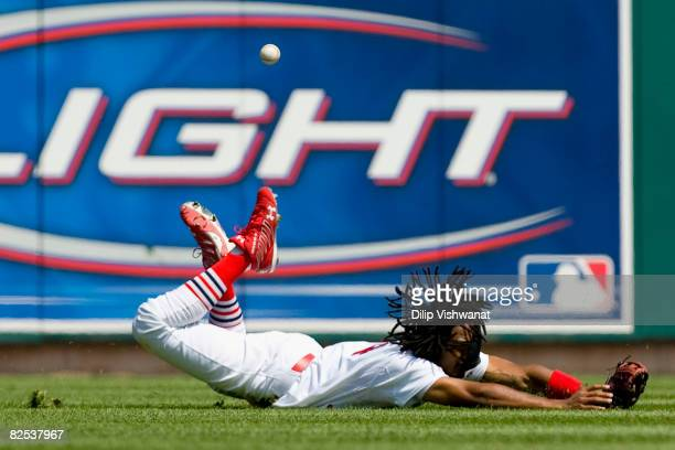 Brian Barton of the St Louis Cardinals misses catching a deep fly ball against the Atlanta Braves at Busch Stadium on August 24 2008 in St Louis...