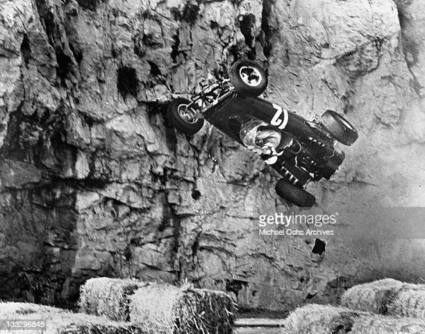Brian Bedford BRM car climbs a cliffside wall after his collision in a scene from the film 'Grand Prix' 1966