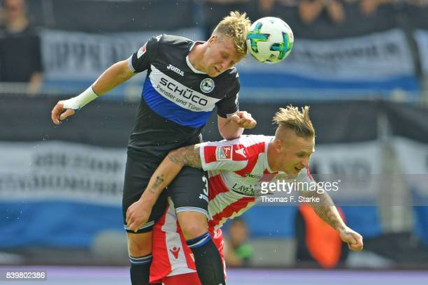 Brian Behrendt of Bielefeld and Sebastian Polter of Berlin head for the ball during the Second Bundesliga match between 1 FC Union Berlin and DSC...