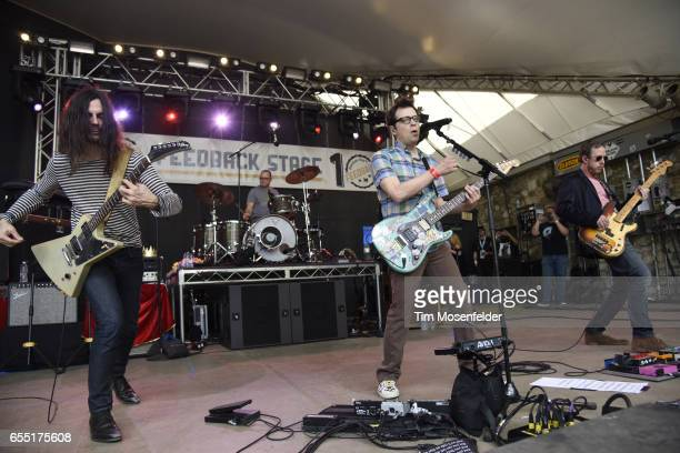 Brian Bell Patrick Wilson Rivers Cuomo and Scott Shriner of Weezer perform during the Rachael Ray Feedback party at Stubb's BarBQue during the 2017...
