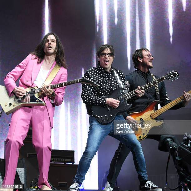 Brian Bell Rivers Cuomo and Scott Shriner of Weezer perform at Coachella Stage during the 2019 Coachella Valley Music And Arts Festival on April 20...