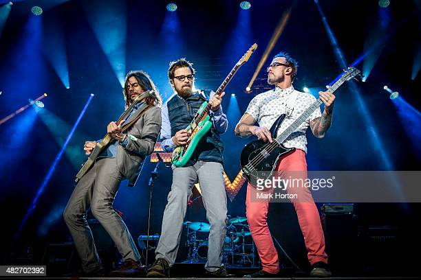 Brian Bell Rivers Cuomo and Scott Shriner of Weezer perform on Day 2 of the Osheaga Music and Art Festival on August 1 2015 in Montreal Canada