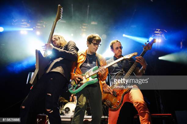 Brian Bell Rivers Cuomo and Scott Shriner of Weezer perform on Day 3 of the Forcastle Festival on July 16 2017 in Louisville Kentucky