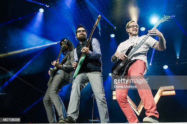 Brian Bell Rivers Cuomo and Scott Shriner of Weezer perform on Day Two of the Osheaga Music and Arts Festival on August 1 2015 in Montreal Canada