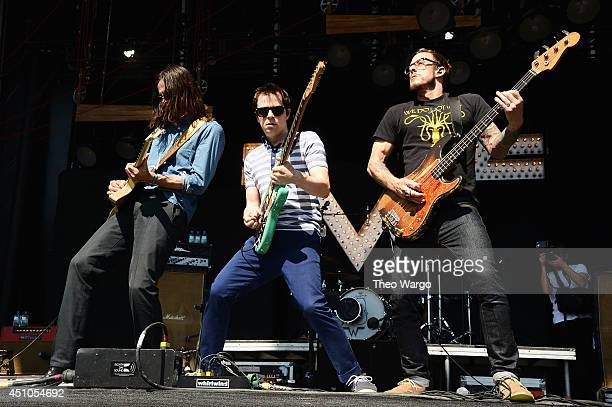 Brian Bell Rivers Cuomo and Scott Shriner of Weezer perform onstage during day 4 of the Firefly Music Festival on June 22 2014 in Dover Delaware