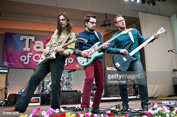 Brian Bell Rivers Cuomo and Scott Shriner of Weezer performs on Day One of the Taste Of Chicago on July 8 2015 in Chicago Illinois
