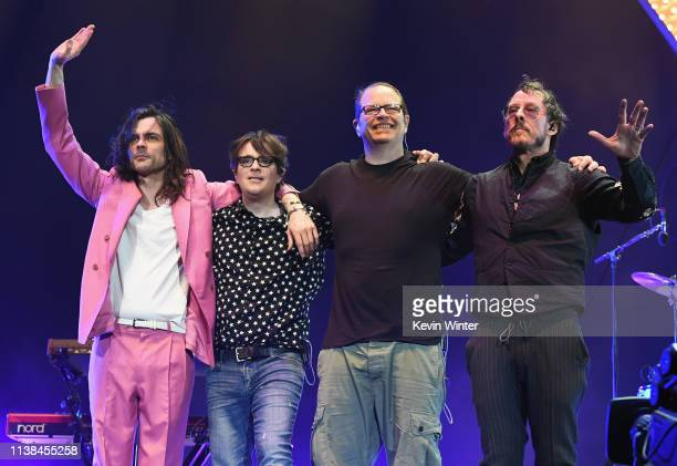 Brian Bell Rivers Cuomo Patrick Wilson and Scott Shriner of Weezer pose onstage at Coachella Stage during the 2019 Coachella Valley Music And Arts...