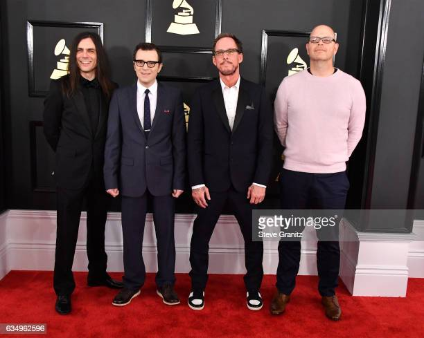Brian Bell Rivers Cuomo Scott Shriner and Patrick Wilson of Weezer attend The 59th GRAMMY Awards at STAPLES Center on February 12 2017 in Los Angeles...